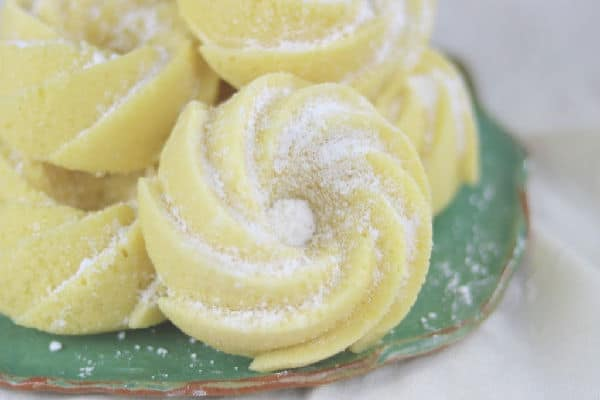 closeup of small lemon pound cakes dusted with sugar.