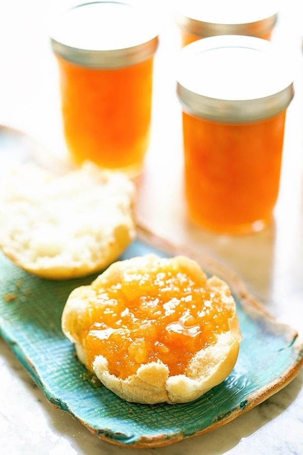 Apricot Pineapple Jam on biscuit on blue plate