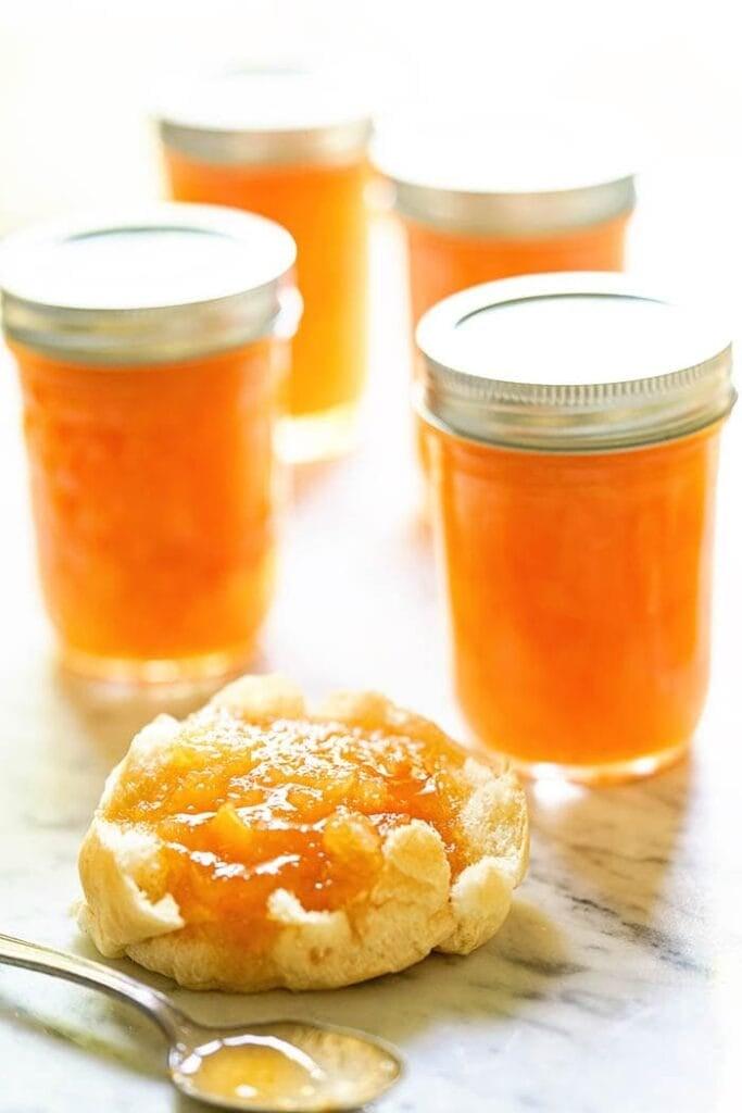 Homemade Jam on biscuit on white platter