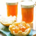 Apricot Jam on biscuit on blue plate