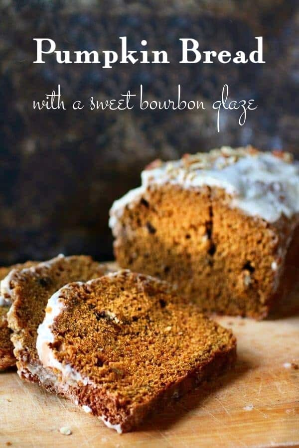 loaf of pumpkin bread sliced to show texture. Title text overlay.