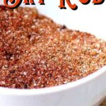 A bowl of the dry rub mix on a table.