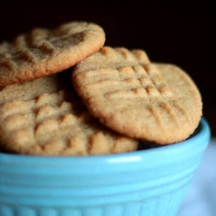 Peanut butter cookies in a bowl showing texture of the cookies.