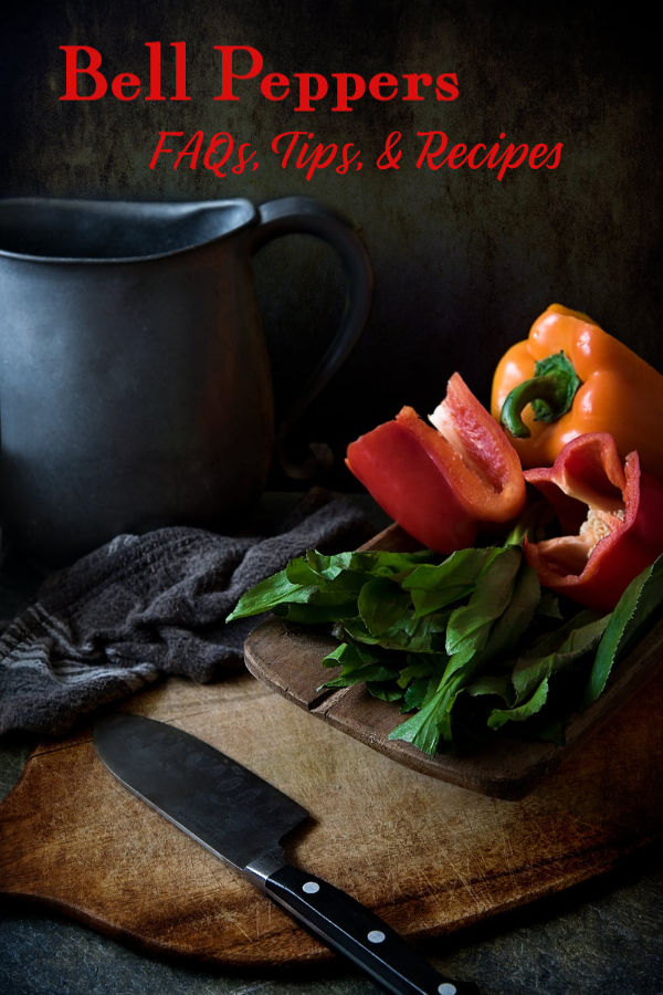 red and orange bell peppers on a cutting board.