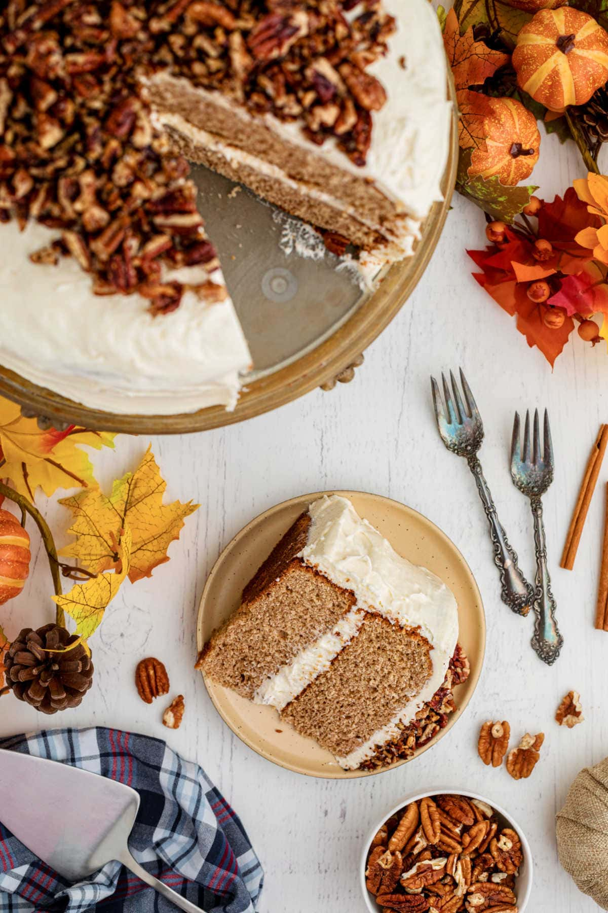 Overhead view of a table with a spice cake on it.