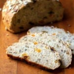 Slices of freshly baked muesli bread showing the dried fruit inside.