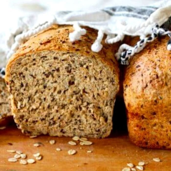 Close up of a slice of multigrain flaxseed bread showing texture.