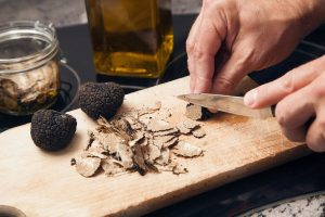 closeup of someone slicing truffles