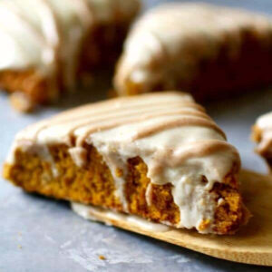 Baked pumpkin scones glazed with icing.