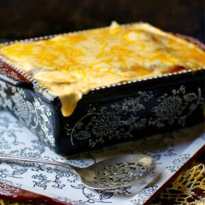 Casserole dish of. cheesy au gratin potatoes on a table.