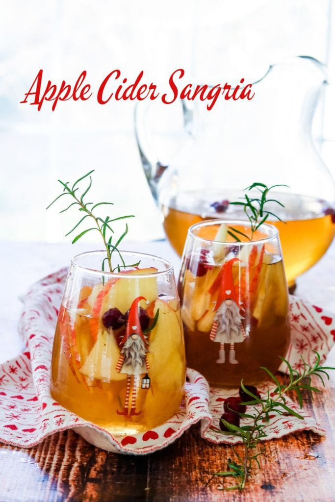 Two glasses of apple cider sangria garnished with rosemary - title text overlay
