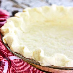 unbaked pie crust in a glass pie pan.