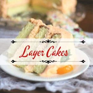 slice of orange layer cake with title text overlay for layer cake category