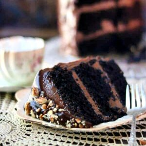 slice of triple layer chocolate cake with mocha frosting and filling.