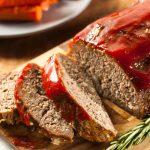 Sliced Homemade meatloaf on a cutting board showing the finished recipe