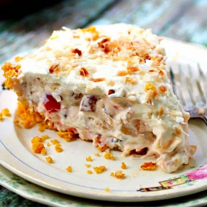 A slice of creamy millionaire pie with toasted coconut on top