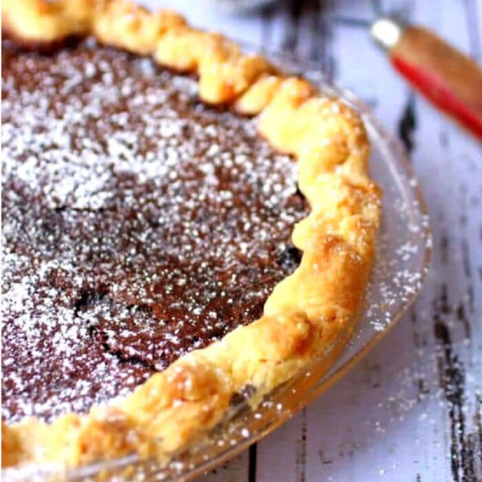 Close up of chocolate chess pie waiting to be sliced.