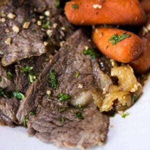 Sliced beef rump roast on a plate.
