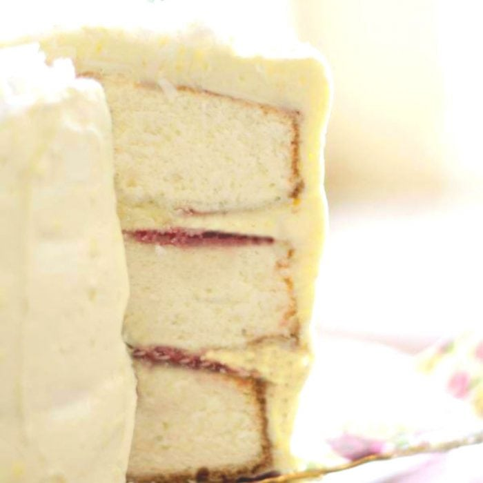 Coconut layer cake with a slice out of it to show the layers