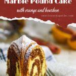 Slice of orange and bourbon marble pound cake o a plate.
