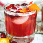 Close up of a cranberry whiskey sour in an on the rocks glass.