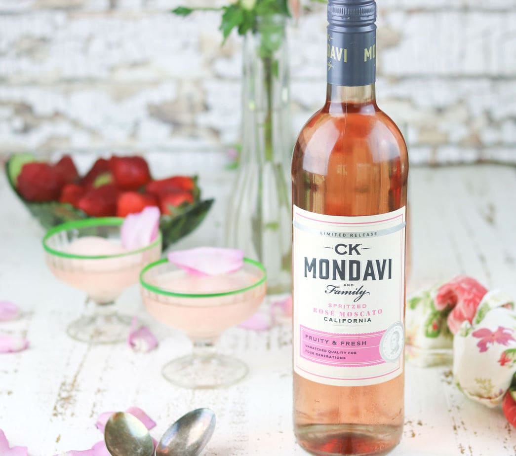 A bottle of CK Mondavi and Family Rose Moscato with pink sorbet in the background.