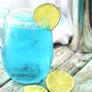 bright blue vodka cocktail in a clear glass.