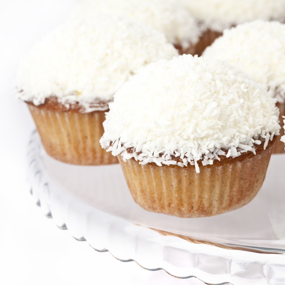 Coconut cupcakes on a plate.