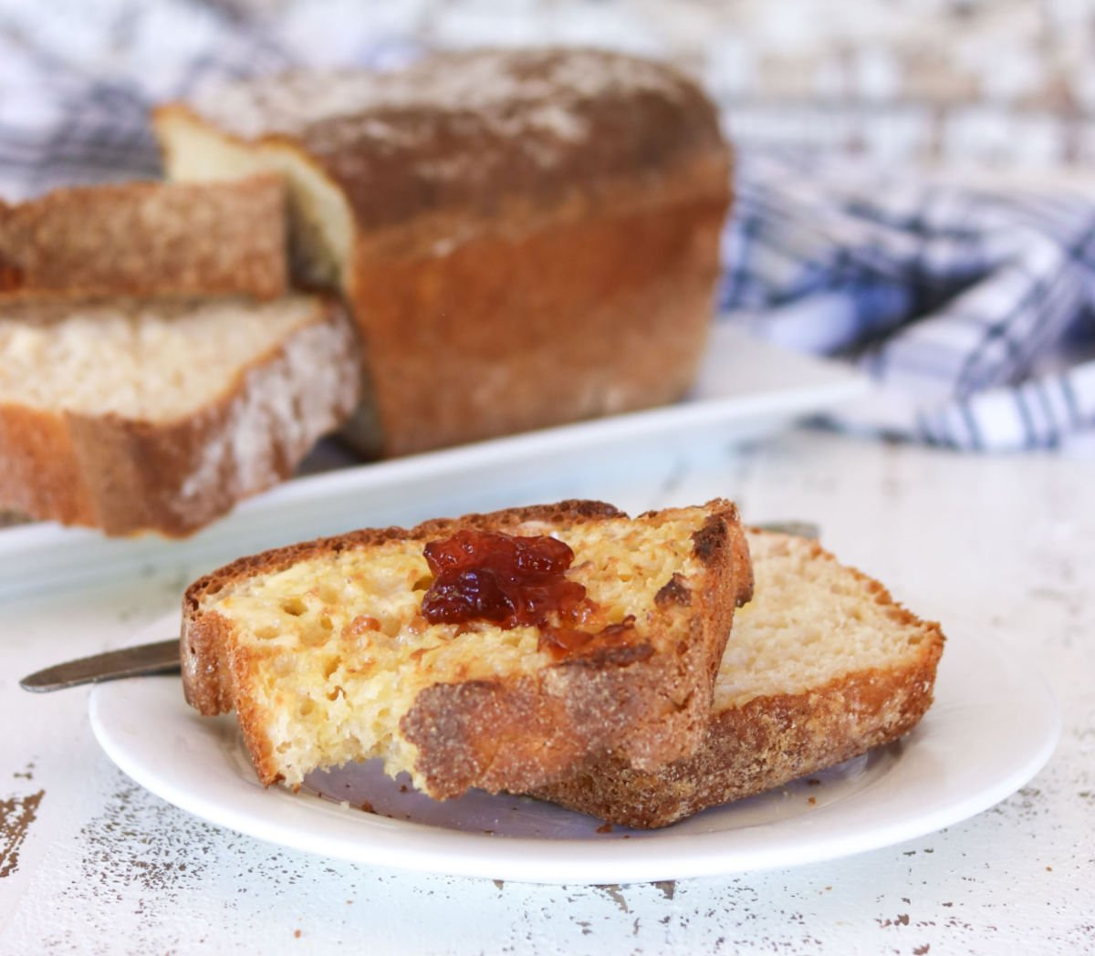 A slice of toasted english muffin bread with jam.