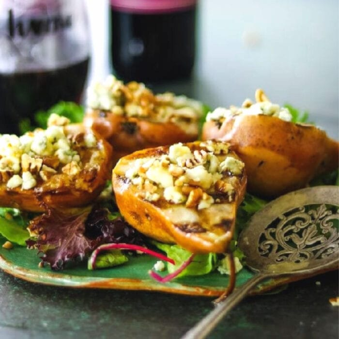 Grilled pear salad on a green serving dish.
