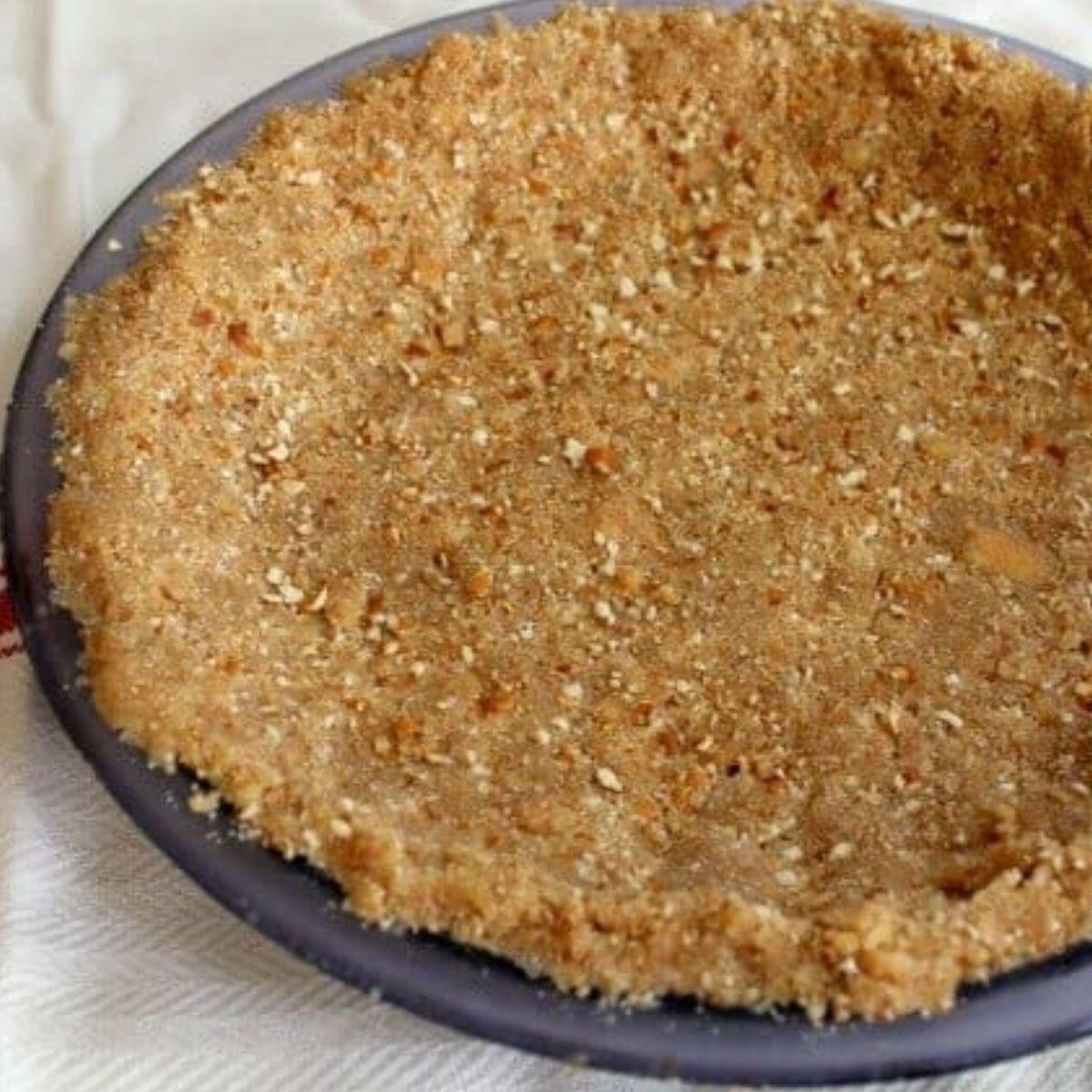 finished crumb crust in a pie plate.