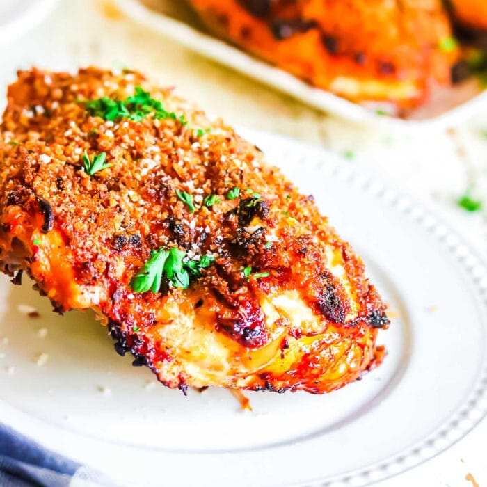 Crispy baked chicken on a white plate.