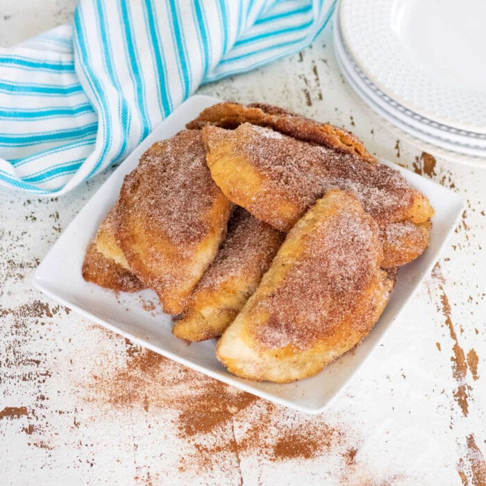 Hand pies covered in cinnamon sugar.