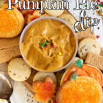 Pumpkin dip in a bowl with cookies arranged around it. Title image.