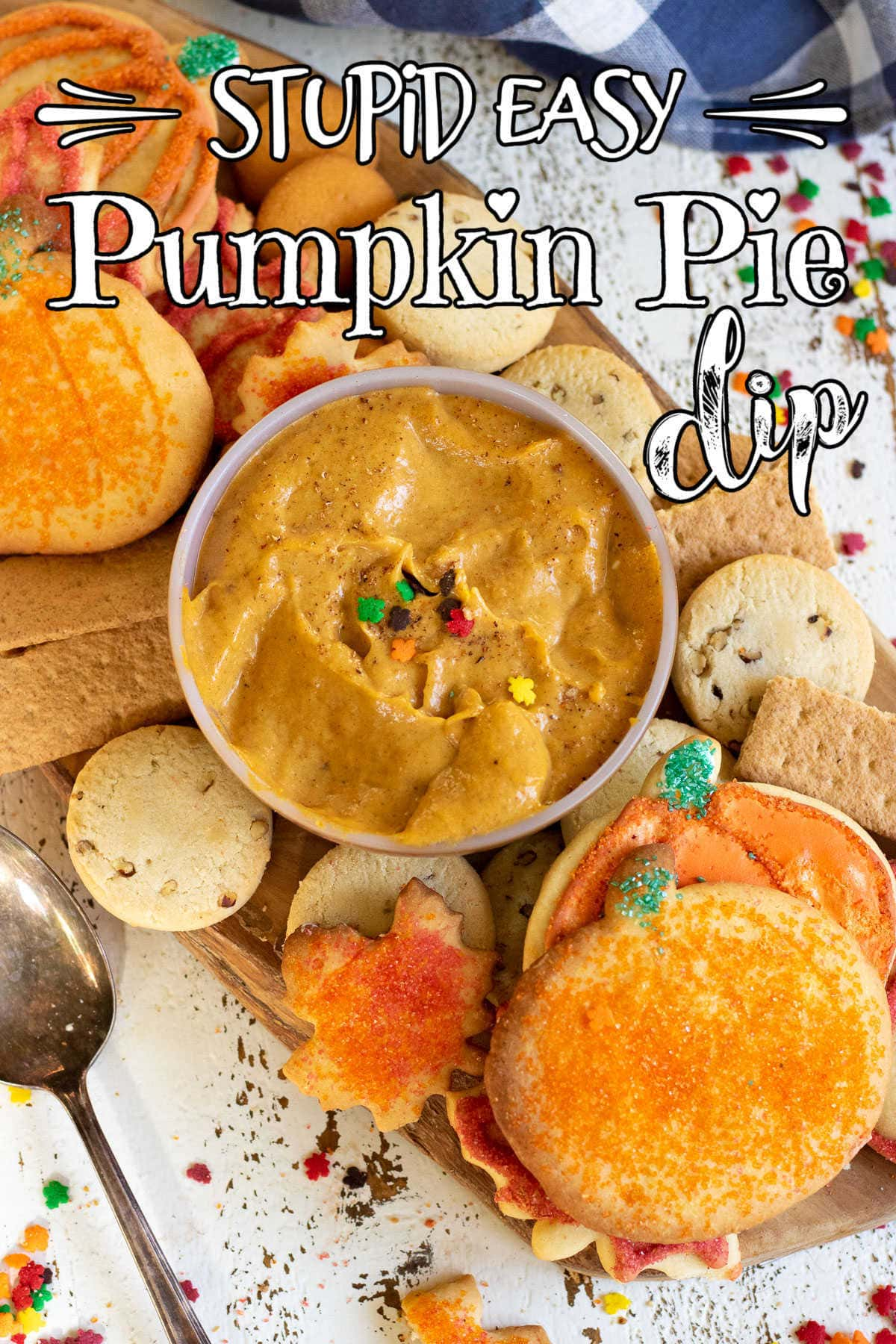 Bowl of pumpkin dip in the center of an arrangement of cookies. Text overlay for Pinterest.