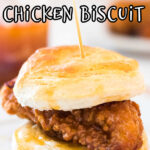 A honey butter chicken biscuit on a plate.