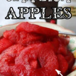 Red apple rings in a serving dish with text overlay for Pinterest.