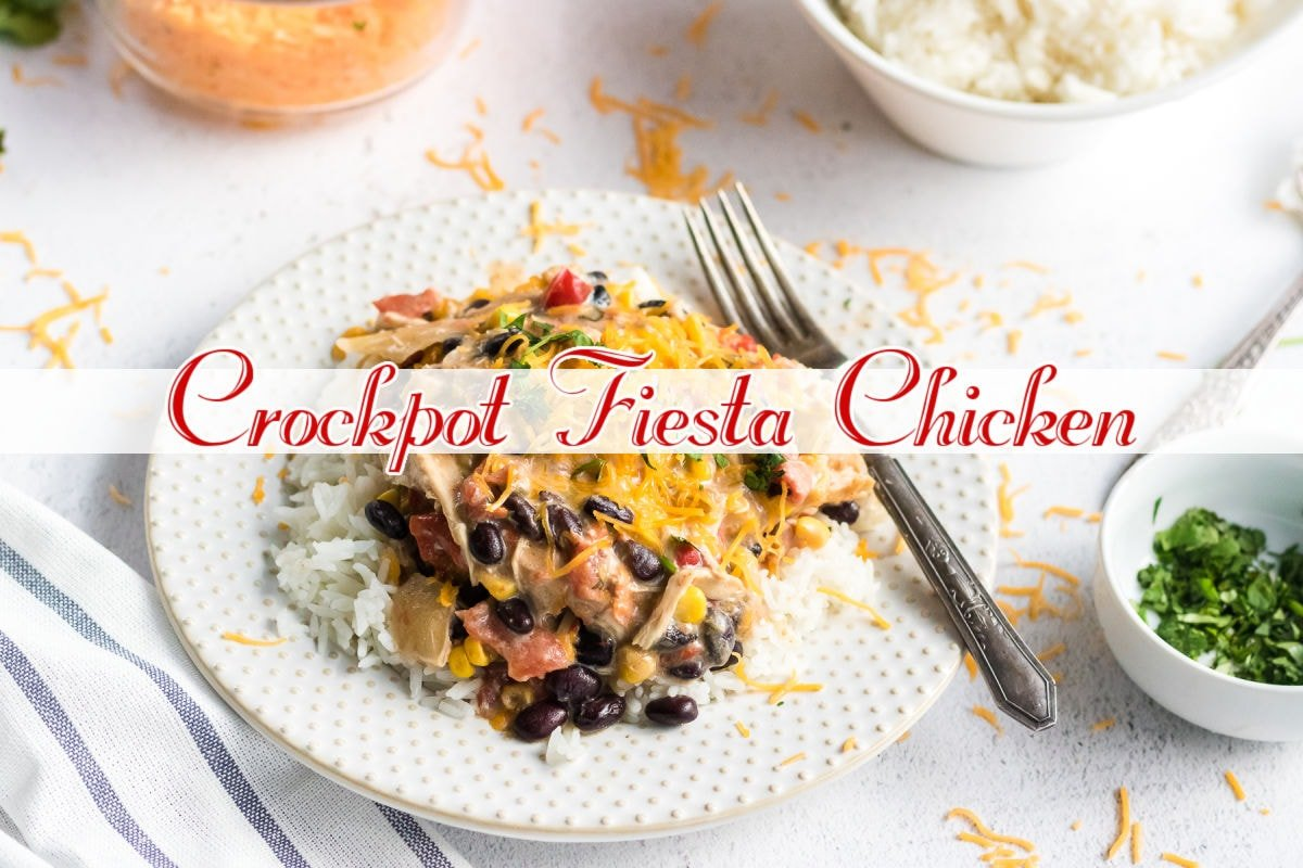 Fiesta chicken over rice on a white plate. Image is clickable and takes you to the YouTube video.