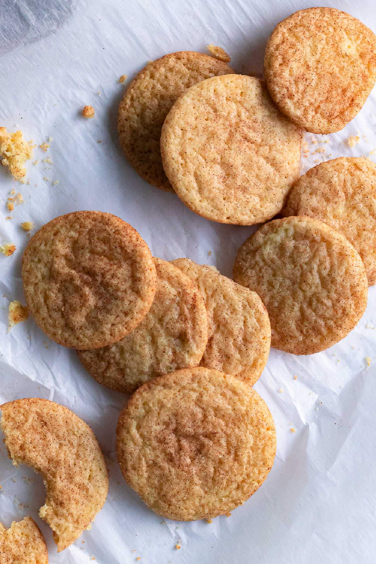 A pile of snickerdoodle cookies on parchment.