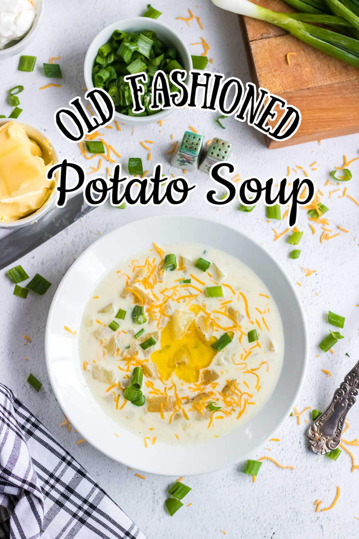 Bowl of creamy  homemade potato soup with butter melting on top in a white bowl. Title text overlay.