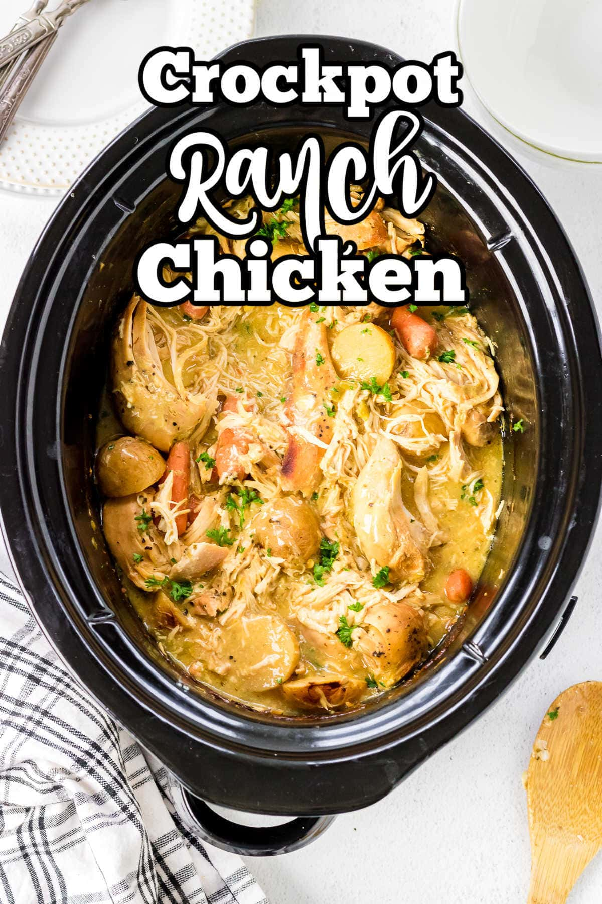 Overhead view of a crockpot with chicken, gravy, and potatoes in it.