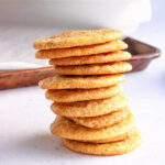 Homemade snickerdoodle cookies in a stack.