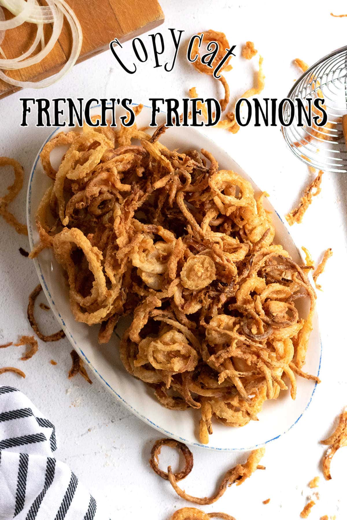 Overhead view of a platter of finished fried onions.