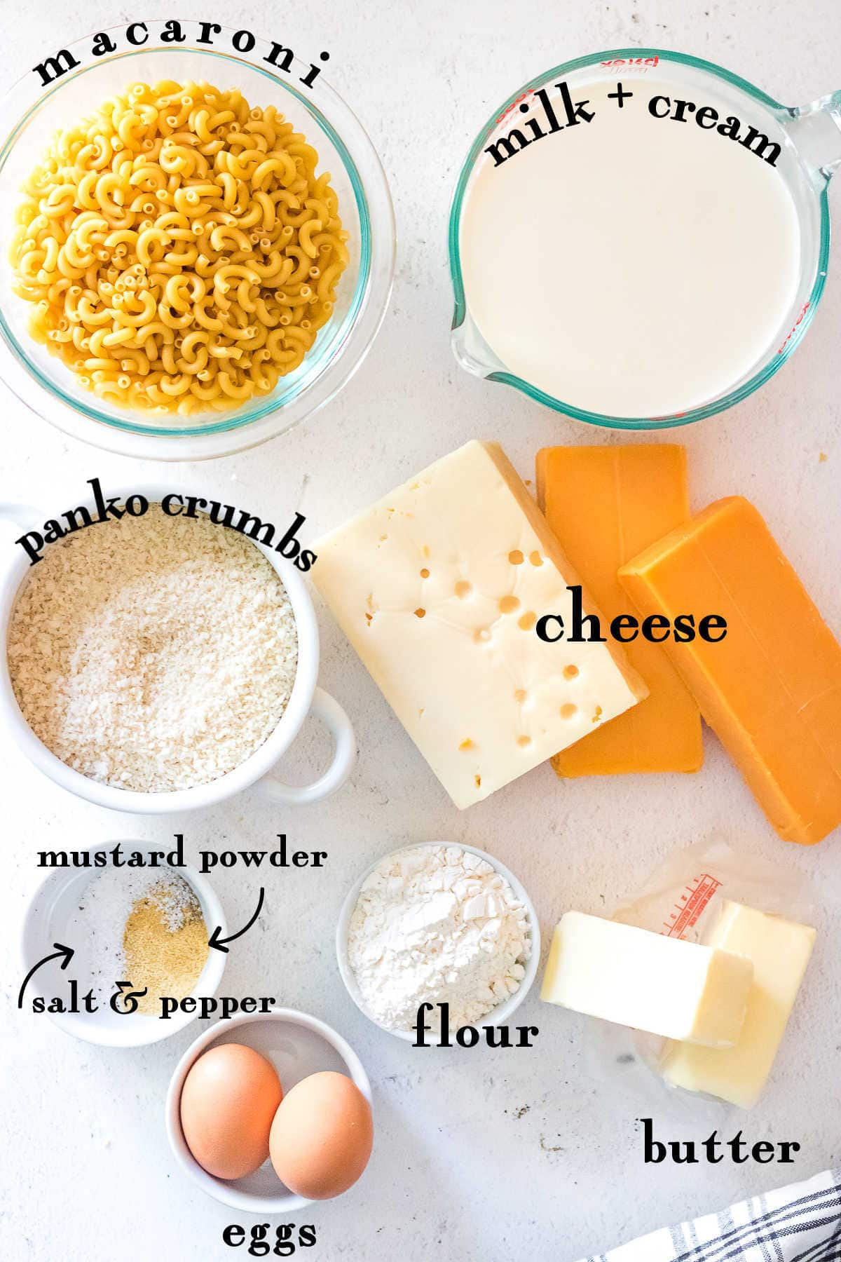 Labeled ingredients for macaroni and cheese recipe.