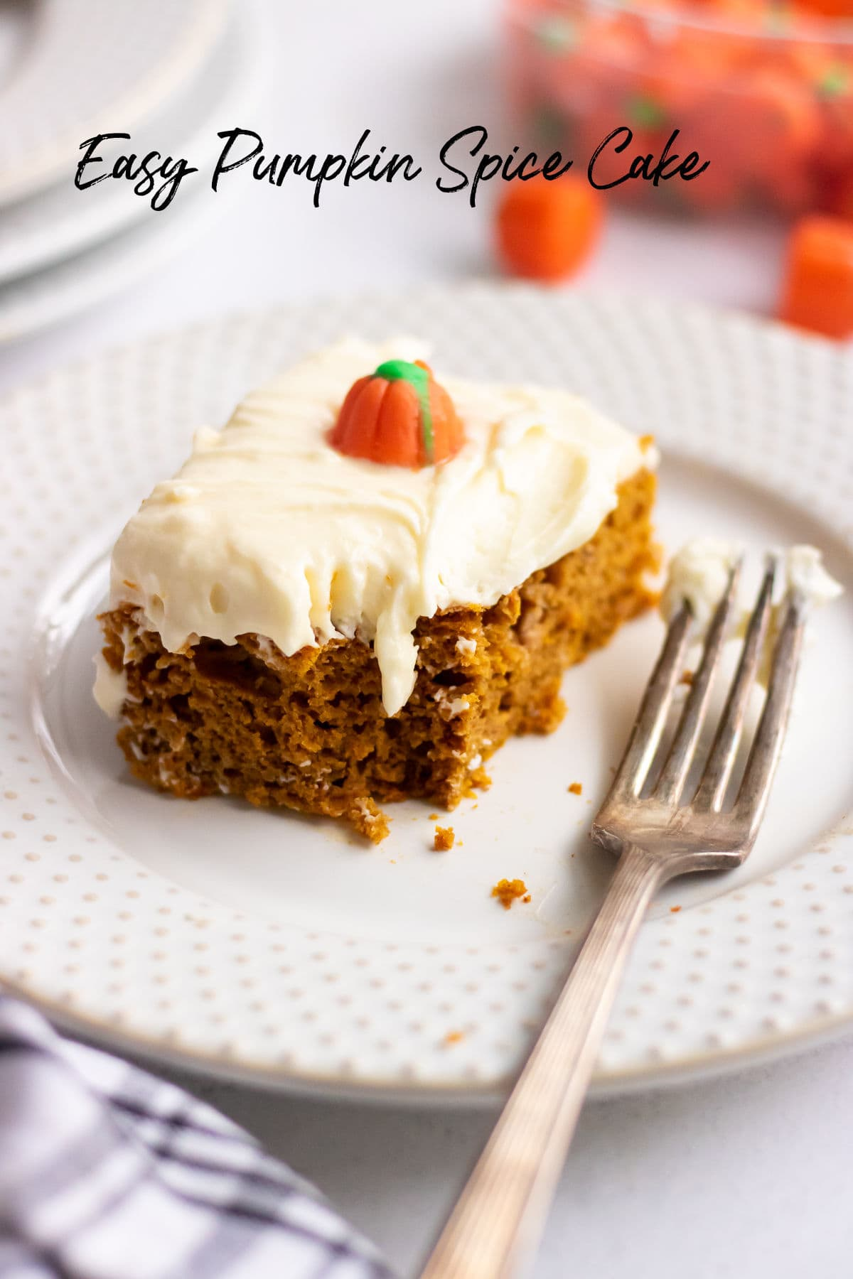 Pumpkin spice cake with a bite taken out. Title text overlay.
