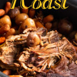 Finished roast and vegetables in a slow cooker with title text overlay.