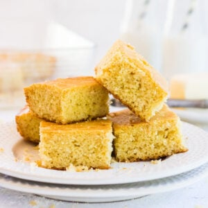 Stack of cut cornbread squares ready to be served.