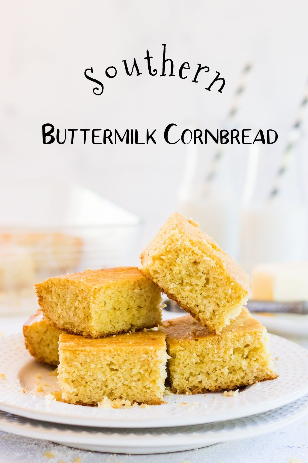 Stacked squares of cornbread with text overlay. Title image.