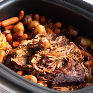 Closeup of meat and vegetables in the slow cooker.