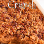 Closeup of sweet potato casserole with text overlay for Pinterest.